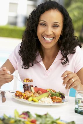 middle aged woman enjoying a healthy meal